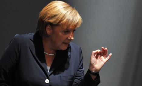 Merkel calls for global financial market tax