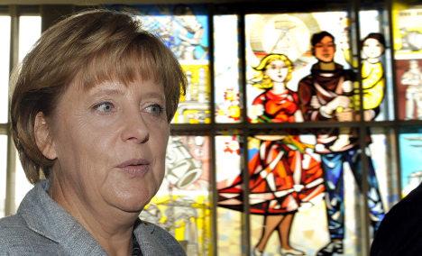 Merkel still hoards after East German upbringing, she says