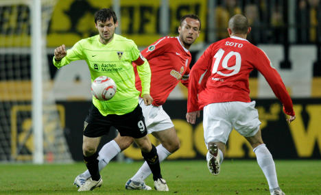 Mainz and Dortmund edged out of German Cup in surprise defeats
