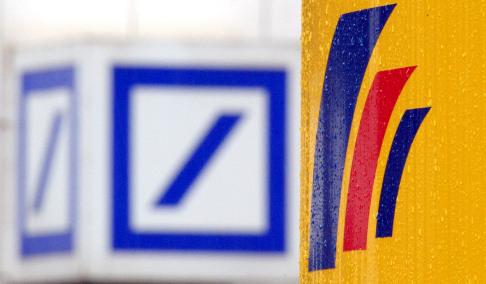 Deutsche Bank books loss from Postbank buy