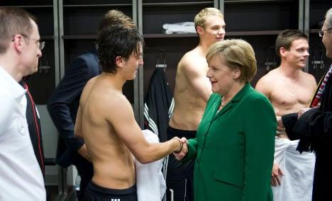 Merkel tries to calm locker room visit hubbub