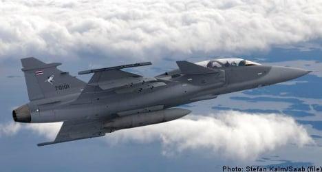 Defence concern Saab lowers annual forecast