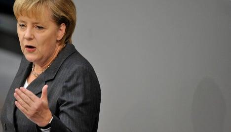 Merkel defends Franco-German deficit plan