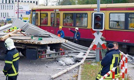 Berlin S-Bahn train crashes into truck