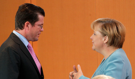 Rising star Guttenberg outshines Merkel