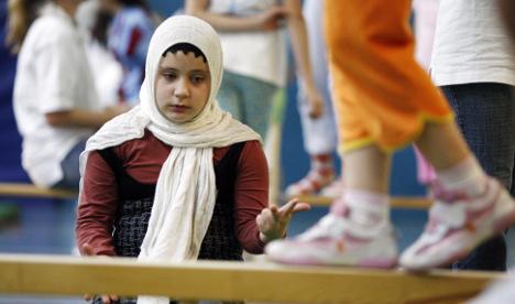 Speak German on school grounds, FDP urges