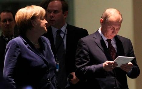 Putin backtracks on trade zone after Merkel's cool response