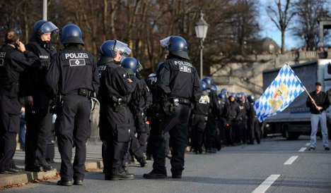 Police stick to refusal to make officers wear identifying badges