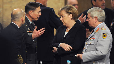 NATO sets timetable to leave Afghanistan by end of 2014
