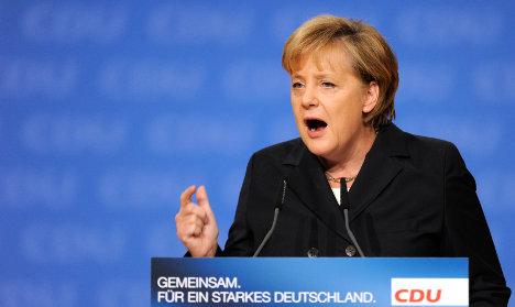Feisty Merkel fires up conservatives