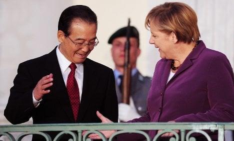 China promises Merkel help with debt crisis