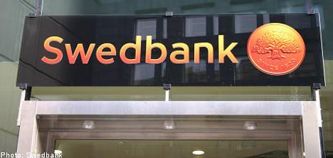 Swedbank bounces back into the black