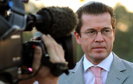 Guttenberg drops Dr. title