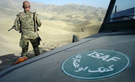 Afghan police say woman killed by German troops
