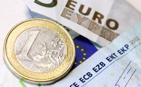 Merkel: EU conservatives ready to defend euro