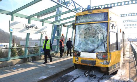 Dozens injured in tram collision with bus