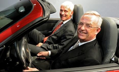 Porsche merger with VW delayed