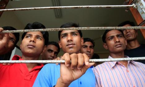 Merkel demands Burma free political prisoners