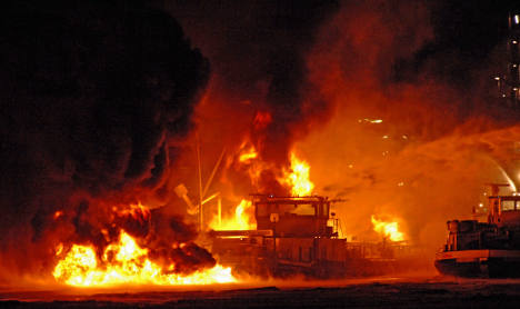 Tanker sinks after explosions at refinery