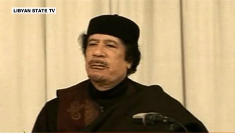 Merkel demands Qaddafi step down immediately