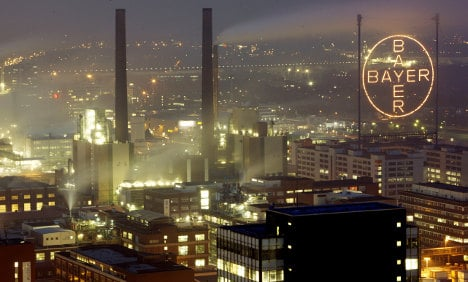 Bayer raises outlook on strong results
