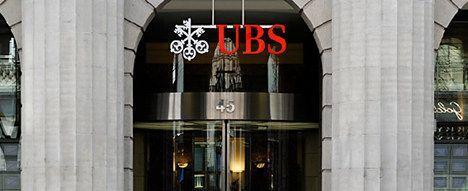Taxes hit UBS profits