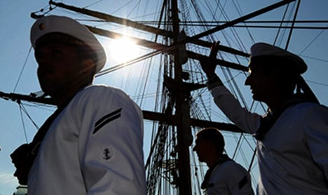 Controversial naval training ship sails into port as question linger