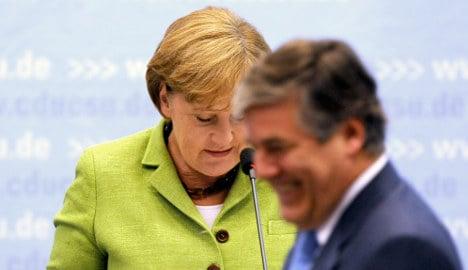 Merkel tells bankers to help bailout Greece