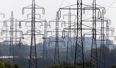 Study sees no power price hikes as Merkel touts nuclear phaseout