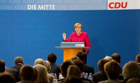 Merkel repeats call for bank aid in debt crisis