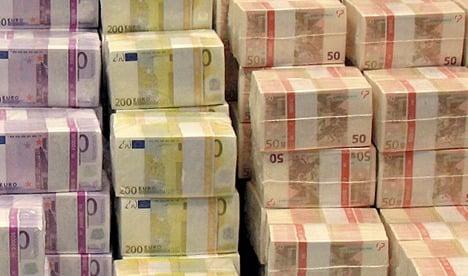 Family firms blast Merkel over debt crisis
