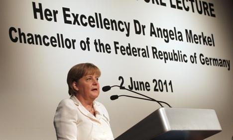 Merkel calls on ASEAN to pressure Burma