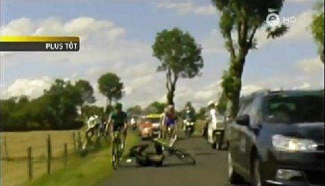 TV car upends Tour de France cyclists
