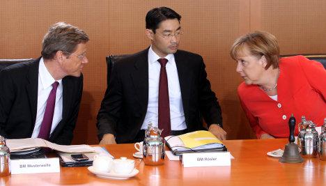 Merkel's cabinet backs budget and tax cuts
