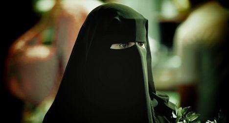 Passenger hits driver in 'burqa ban' bust-up