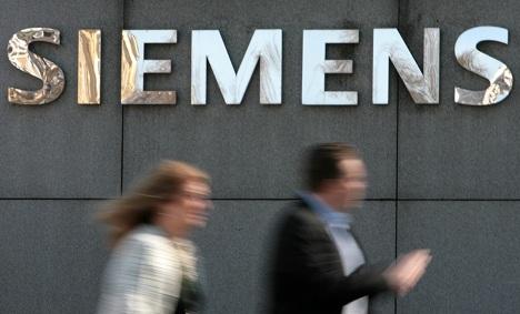 Siemens third quarter profits dip