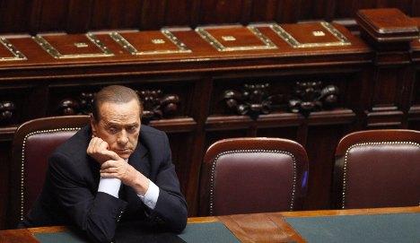 Merkel calls for Italian cuts to steady eurozone