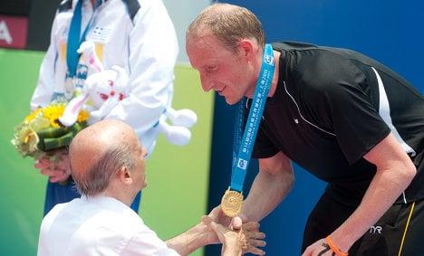 Open water swimmer Lurz takes fifth world title