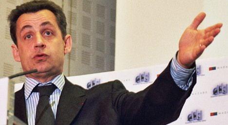 Sarkozy denies taking cash from Bettencourt