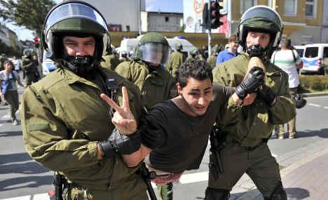 Police clash with anti-Nazi protesters