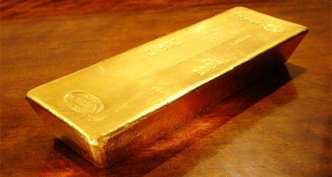 Gold's status boosted as Swiss weaken franc