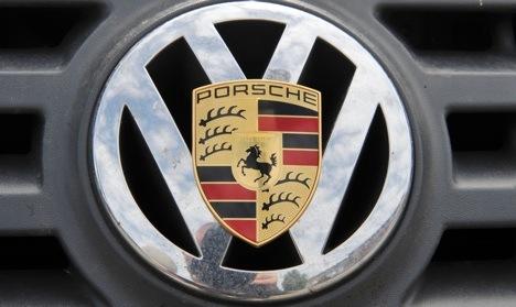 Volkswagen and Porsche delay merger