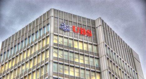 UBS shrinks investment bank, halves risky assets