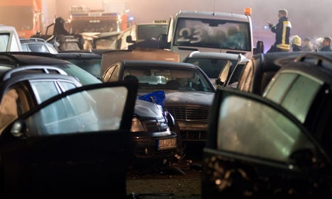 Eight die in mass pile-up and head-on collision