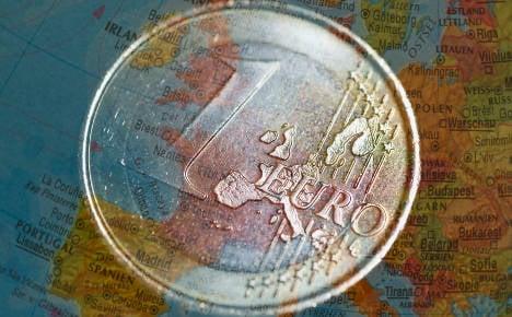 Merkel denies mulling plan to split eurozone