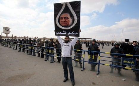 German fury at raids on groups in Cairo