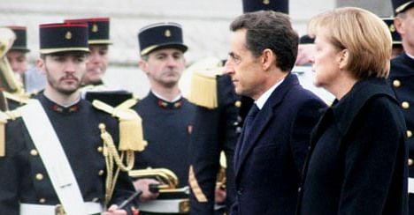 Sarkozy and Merkel demand tough new pact