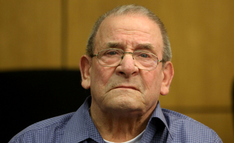 Elderly Nazi killer begins life prison term