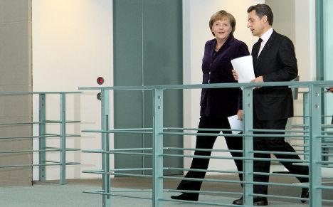 Merkel, Sarkozy vow to solve eurozone crisis