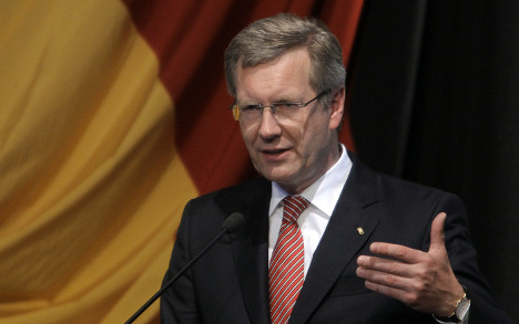 Merkel sticks by embattled president